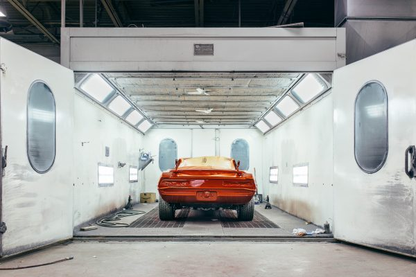 red car in spray booth